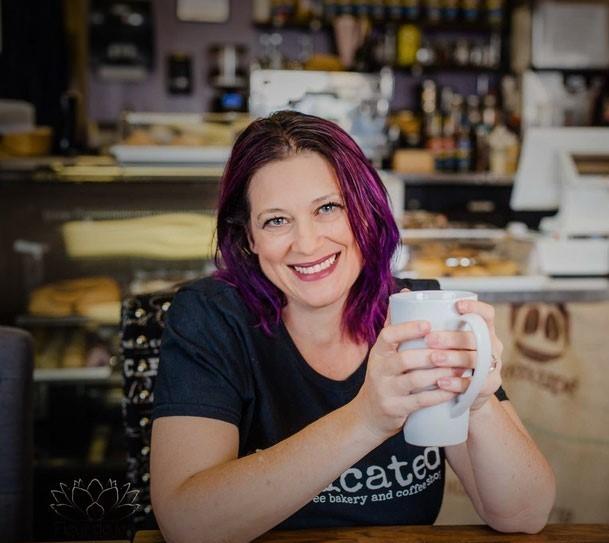 rebecca at a desk with a mug image